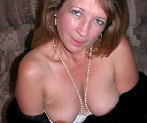 Mature lady removes her fur coat to shows her pierced twat for the first time
