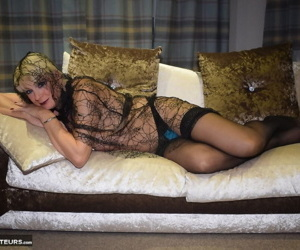 Aged blond woman Dimonty wraps herself in a see thru shawl while getting naked