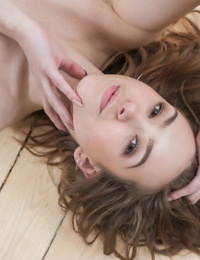 Thin first timer slips off skirt and thong to model nude on hardwood flooring