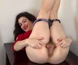 Mature mom Sadie Lune takes off her skirt and shows hairy pussy