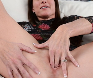 Middle-aged lady Sofie Marie inserts two fingers into her shaved vagina