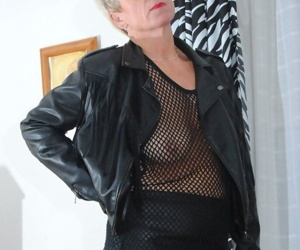 Sexy mature lady Dimonty models in see thru attire after removing leather coat