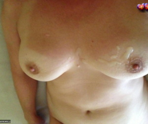 Mature amateur Busty Bliss catches jizz on her tan lined tits in POV mode
