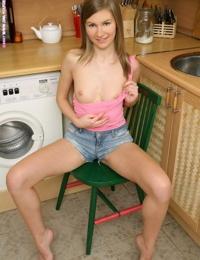 Innocent brunette fucks cucumber in kitchen - part 4690