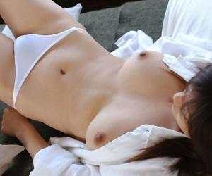Young Japanese girl Sakura Shiratori sets her nice tits and and bush free