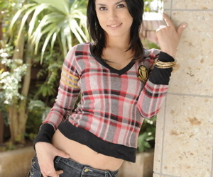 Hot dark haired MILF Maria Ozawa poses seductively outdoors in sexy shorts