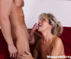 Naked mature woman gets banged on the sofa by her younger lover