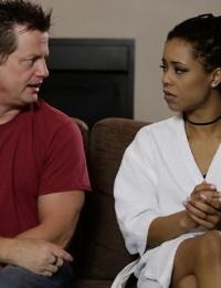 Young ebony slut Kira Noir talking to her husband in her bathrobe