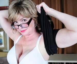 Chubby American librarian cups her mature boobs after disrobing at home