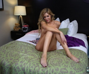 Honey with glasses Emily Kae undresses quickly and demonstrates slender body
