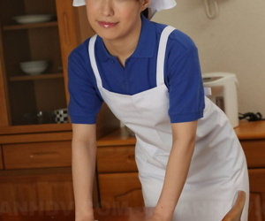 Japanese female Yukari Toudou does her housework in white apron and hat