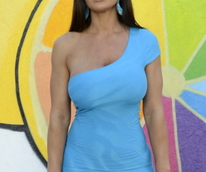 Legendary American MILF Lisa Ann shows juicy tits and spreads ass cheeks