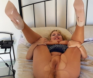 Hot mature blonde Lorna Blu in ripped pantyhose gets on her knees to rub pussy