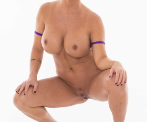 Spectacular MILF Shay Fox strips her purple bikini off and poses in heels