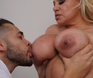 Mature blonde with big boobs and tattoos is stripped naked by her toy boy