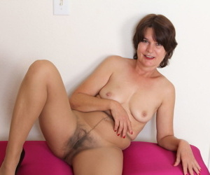 Hot older woman displays her natural pussy in and out of tan pantyhose