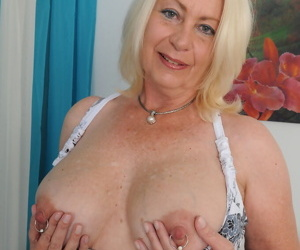 Sexy mature fatty Angelique displaying pierced nipples & stretching pussy lips