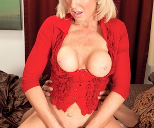 40 something blonde seduces a younger man in black miniskirt