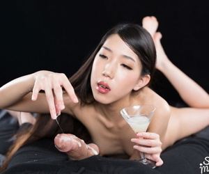 Slim Japanese girl eats sperm after spitting cum into a martini glass