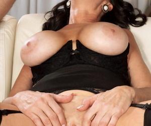 Hot older woman Rita Daniels seduces her young lover in sensual lingerie