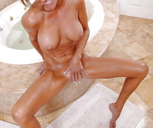 Sexy mom Montana Skye taking a hot bath and masturbating with a shower