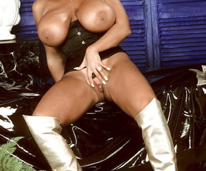 Mature pornstar Tawny Peaks revealing monster tits in boots and hat