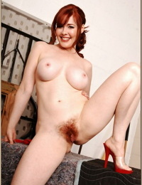 Redheaded MILF Mae Victoria demonstrates shapely tits and hairy pussy