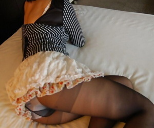 Dirty-minded asian MILF Seiko Kuramoto undressing on the bed