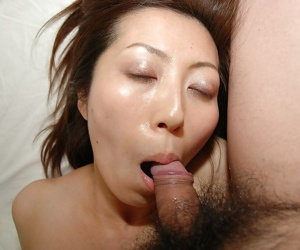 Slutty asian MILF gobbles a boner and gets her hairy twat shagged