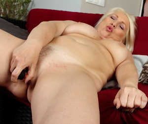 Close ups of buxom mature blonde Netty toying trimmed vagina