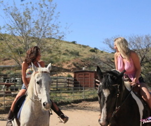 Cowgirls Veronica Avluv & Devon Lee finish up a horse ride with lesbian sex