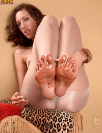 Hot girl in sleek white pantyhose Kitty Wildwood showing off toes and booty