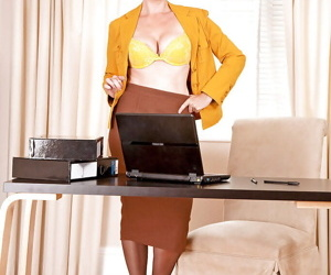 Mature office lady showing off her sexy curves and nice legs in stockings