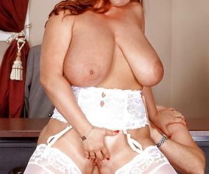 Busty stocking clad aged redhead secretary Cherry Brady giving bj in office