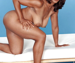 Mature ebony babe Semmie deSoura demonstrating her fine tits and round ass