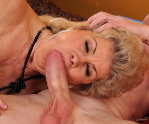 Insatiable big tit granny Effie masturbates and gets dicked on red sofa