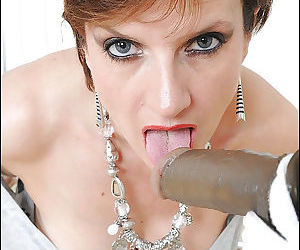 Mature babe sucks a dildo with her hands handcuffed and her nipples pinched