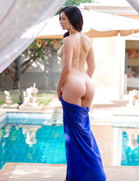 Beautiful young girl Malena gets naked outdoors and spreads shaved cunt