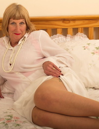 Wild old granny shyly removes her Sunday greatest to show her garter belt and butt