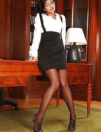 Hot secretary in glasses Angel Pink stripping off her clothes in the office