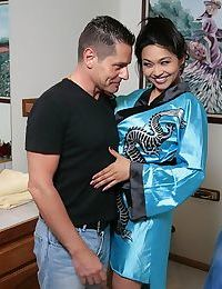 Hot Asian masseuse Mika Tan with big tits giving handjob & footjob in bath