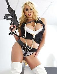 Blonde Asian Mia Lelani posing in white stripper boots with gun in hand