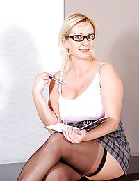 Mature blonde in stockings fondling massive boobs and shaved slit