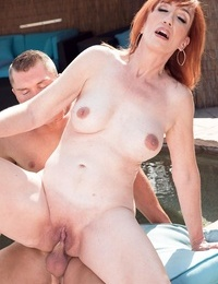 Mature redhead Diamond Crimson heads vagina to facehole with a younger stud