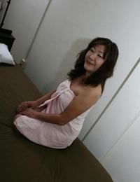 Jiggly asian granny Michiko Okawa toying her furry twat after shower