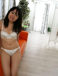 Nasty asian MILF strips down and gets her hairy images finger-tickled