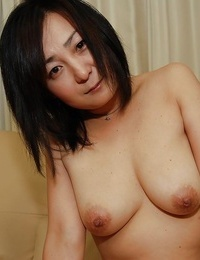Lusty Japanese MILF peels off down and has some beaver vibing fun - part 2
