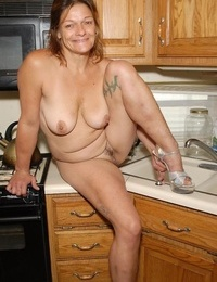 Experienced blonde woman Ivee displaying off g-string adorned butt in kitchen - part 2