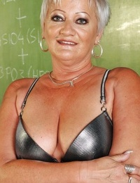 Short haired fatty granny undressing off her dress and lingerie