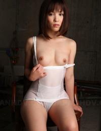 Erotic Japanese model Arisa Suzuki drops white undergarments to unveil small hooters